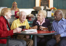 group of elderly people having a breakfast together