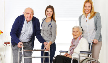 portrait of two caregivers assisting their old patient